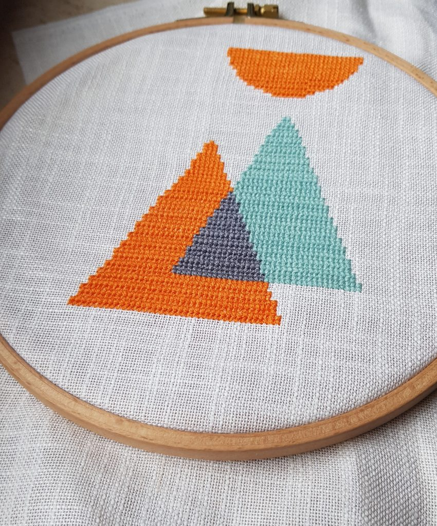 Minimalist cross stitch design in linen fabric